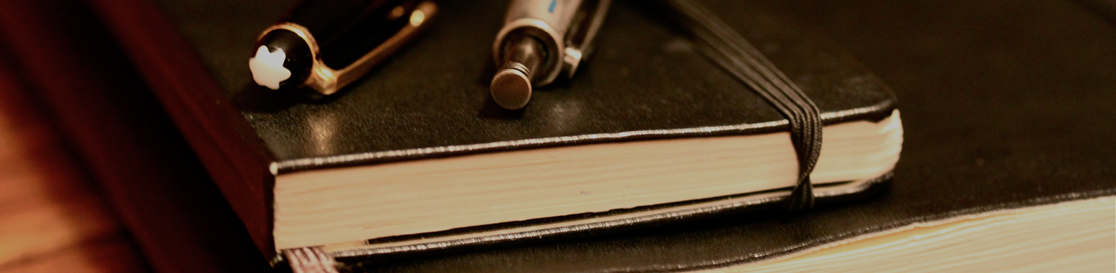 notebook-on-wood-long